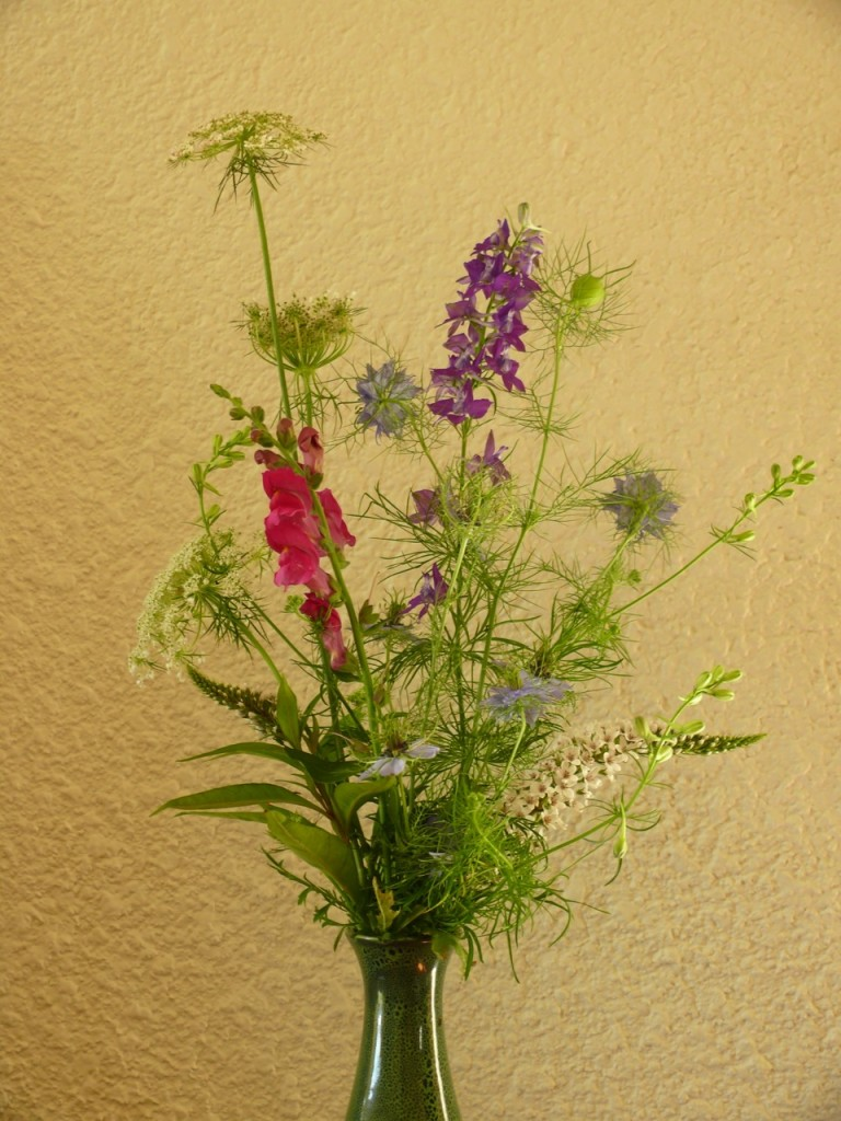 "The arrangement is from the garden, mostly ""wildflowers"", though purposely ..."